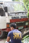 A forensics policeman in front of the ambushed truck. (Photo from Negros Occidental PNP)