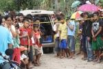 Villagers look on from the police line. (Photo from Negros Occidental PNP)