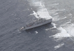 "The USS Guardian, a US Navy minesweeper stuck at the ""protected"" Tubbataha Reef natural park (Photo courtesy of AFP Western Command)"