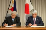 Philippine Defense Secretary Voltaire Gazmin and Japan Defense Minister Gen Nakatani signing a memorandum on defense cooperation. (Japan MoD photo)