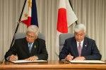 Philippine Defense Secretary Voltaire Gazmin and Japan Defense Minister Gen Nakatani signing a memorandum on defense cooperation. (Japan MoD photo)
